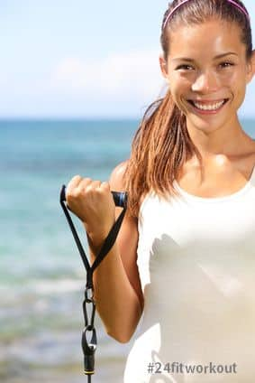 Fitness girl training at beach elastics bands